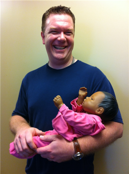 Neal with one of the computerized babies that are distributed to middle and high school students