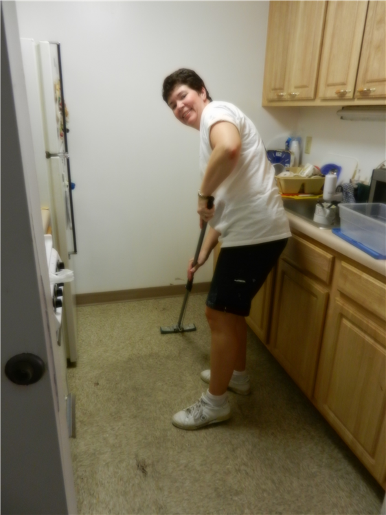 Nancy cleaning an apartment
