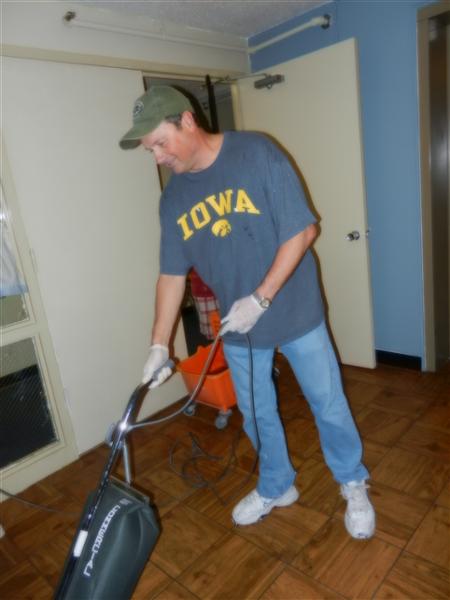 Kurt cleaning an apartment
